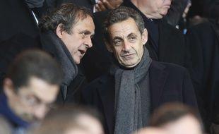 Michel Platini et Nicolas Sarkozy dans les tribunes du Parc des Princes, en 2015.