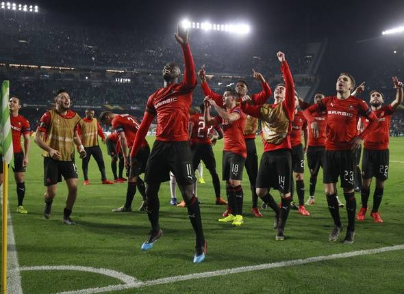 Rennes' players celebrates at the end of the match during the Europa League round of 32 second leg soccer match between Betis and Rennes at the Benito Villamarin stadium, in Seville, Spain, Thursday, Feb. 21, 2019.