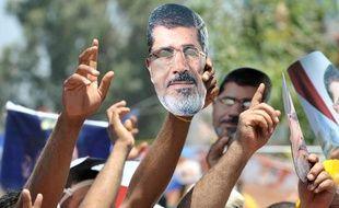 Des partisans de l'ancien président égyptient Mohamed Morsi, destitué par l'armée, le 26 juillet 2013 au Caire, en Egypte.