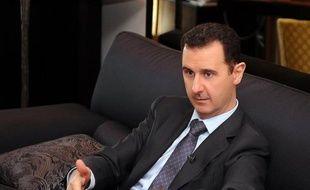 """Le président syrien Bachar al-Assad a estimé que la création d'une zone-tampon en Syrie évoquée par les Occidentaux et la Turquie pour accueillir les réfugiés, est """"irréaliste""""."""