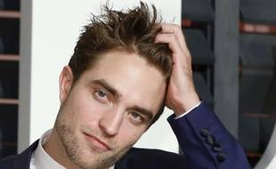 LOS ANGELES - FEB 22:  Robert Pattinson at the Vanity Fair Oscar Party 2015 at the Wallis Annenberg Center for the Performing Arts on February 22, 2015 in Beverly Hills, CA Photo via Newscom/khphotos554141/1502271133