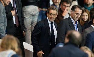 Nicolas Sarkozy à son arrivée le 21 septembre 2014 au Parc des Princes à Paris, après son intervention sur France 2