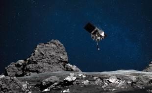 Vue d'artiste obtenue grâce à la Nasa de la sonde Osiris-Rex approchant l'astéroïde Bennu.