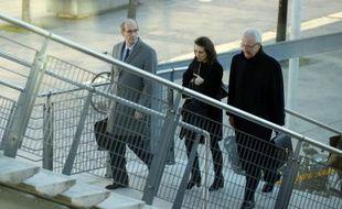 Eric Woerth (g), ex-trésorier de l'UMP, et son avocat, Me Jean-Yves Le Borgne (d) arrivent au palais de justice de Bordeaux, le 10 février 2015