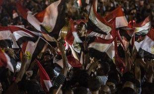Les Egyptiens célèbrent le 3 juin 2014 sur la place Tahir au Caire, la victoire à l'élection présidentielle de l'ancien ministre de la défense et chef de l'armée, le général Abdel Fattah al-Sissi