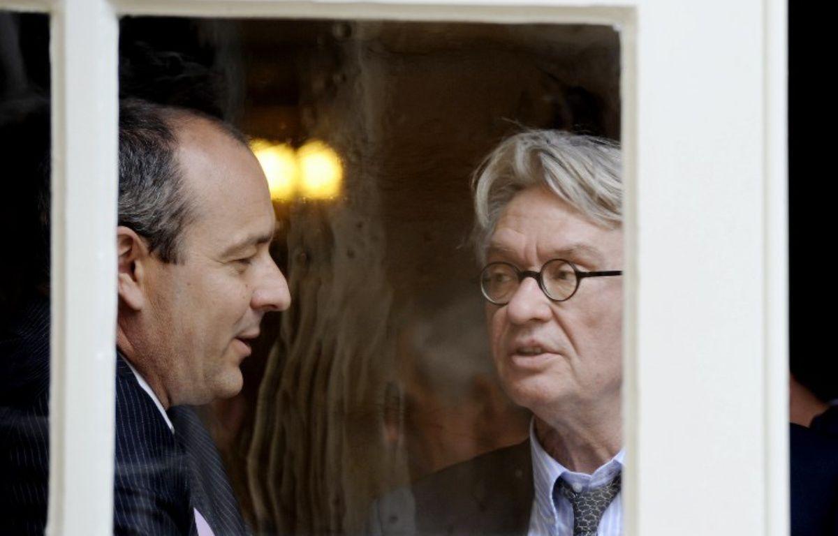 Les deux leaders syndicaux Laurent Berger (CFDT, syndicat majoritaire) et Jean-Claude Mailly (Force ouvrière), le 16 juin 2014. – STEPHANE DE SAKUTIN / AFP