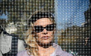 Pamela Anderson, en cage, pour dénoncer les maltraitances animales, à Paris, le 10 octobre 2018.
