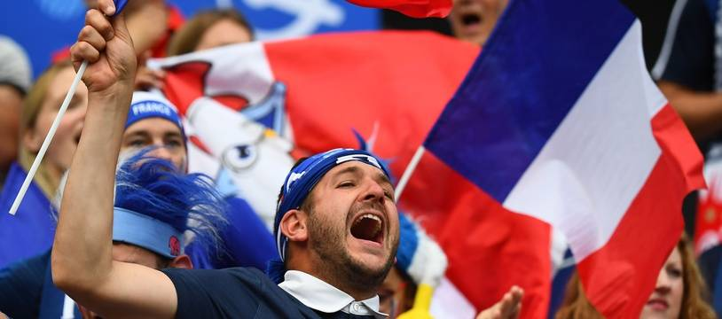 French supporters wave French flags ahead of the France 2019 Women's World Cup round of sixteen football match between France and Brazil, on June 23, 2019, at the Oceane stadium in Le Havre, north western France. (Photo by FRANCK FIFE / AFP)