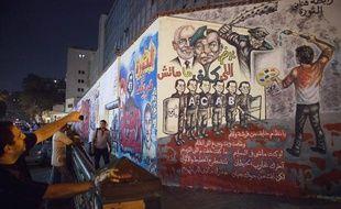 Les caricatures de l'actuel président Mohamed Morsi sur un mur non loin de la place Tahrir, au Caire, le 25 septembre 2012.