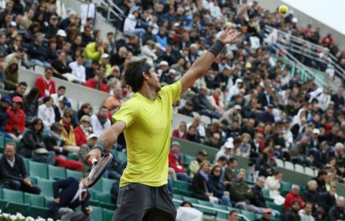 L'Argentin Juan Martin Del Potro a rejoint Roger Federer en quarts de finale de Roland-Garros, en éliminant lundi le Tchèque Tomas Berdych (7-6, 1-6, 6-3, 7-5), dans une partie interrompue la veille par la nuit. – Patrick Kovarik afp.com