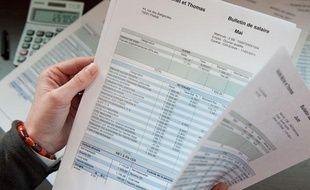 Illustration de fiches de salaire.