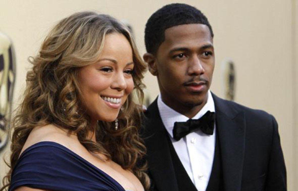 La chanteuse Mariah Carey et son mari, Nick Cannon, arrivent à la 82e cérémonie des Oscars, à Hollywood, le 7 mars 2010. – REUTERS/Mario Anzuoni