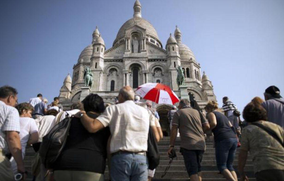 L'association Aide à l'Eglise en détresse prend d'assaut la Basilique du Sacré-Coeur afin de sensibiliser sur les persécutions religieuses effectuées dans le monde entier.  – Lionel Bonaventure AFP