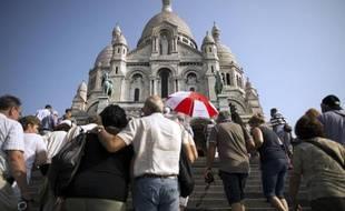 L'association Aide à l'Eglise en détresse prend d'assaut la Basilique du Sacré-Coeur afin de sensibiliser sur les persécutions religieuses effectuées dans le monde entier.