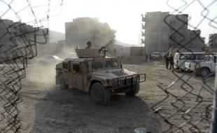 Des policiers afghans lors de l'attaque le 17 juillet 2014 à l'aéroport de Kaboul