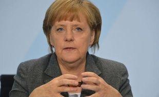 """La chancelière allemande Angela Merkel a estimé samedi qu'il fallait tenir """"pendant cinq ans ou plus"""" pour surmonter la crise de l'euro, lors d'une réunion de son parti à Sternberg (est)."""