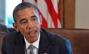 Barack Obama a affirmé avoir échangé des lettres avec le président iranien Hassan Rohani et a averti que sa réticence à frapper la Syrie n'amoindrissait pas la menace américaine d'user de la force s'il faut empêcher l'Iran d'avoir l'arme nucléaire.