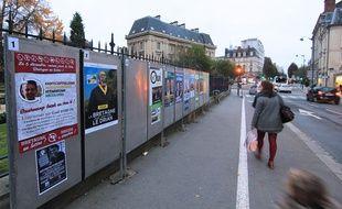 Des panneaux présentant les candidats aux élections régionales en Bretagne. Ici le 1er décembre à Rennes.