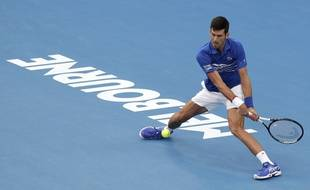 Serbia's Novak Djokovic makes a backhand return to France's Lucas Pouille during their semifinal at the Australian Open tennis championships in Melbourne, Australia, Friday, Jan. 25, 2019.