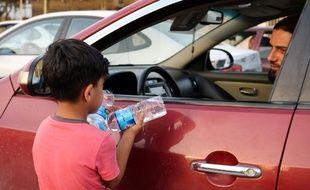 Un enfant mendiant à Mossoul en juillet 2018.