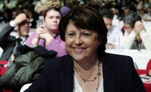 """L'ancienne première secrétaire du PS, Martine Aubry, plaide à nouveau pour l'interdiction du cumul des mandats aux parlementaires, et regrette que la perspective d'une application de la mesure dès les municipales de 2014 semble s'éloigner, """"malheureusement""""."""