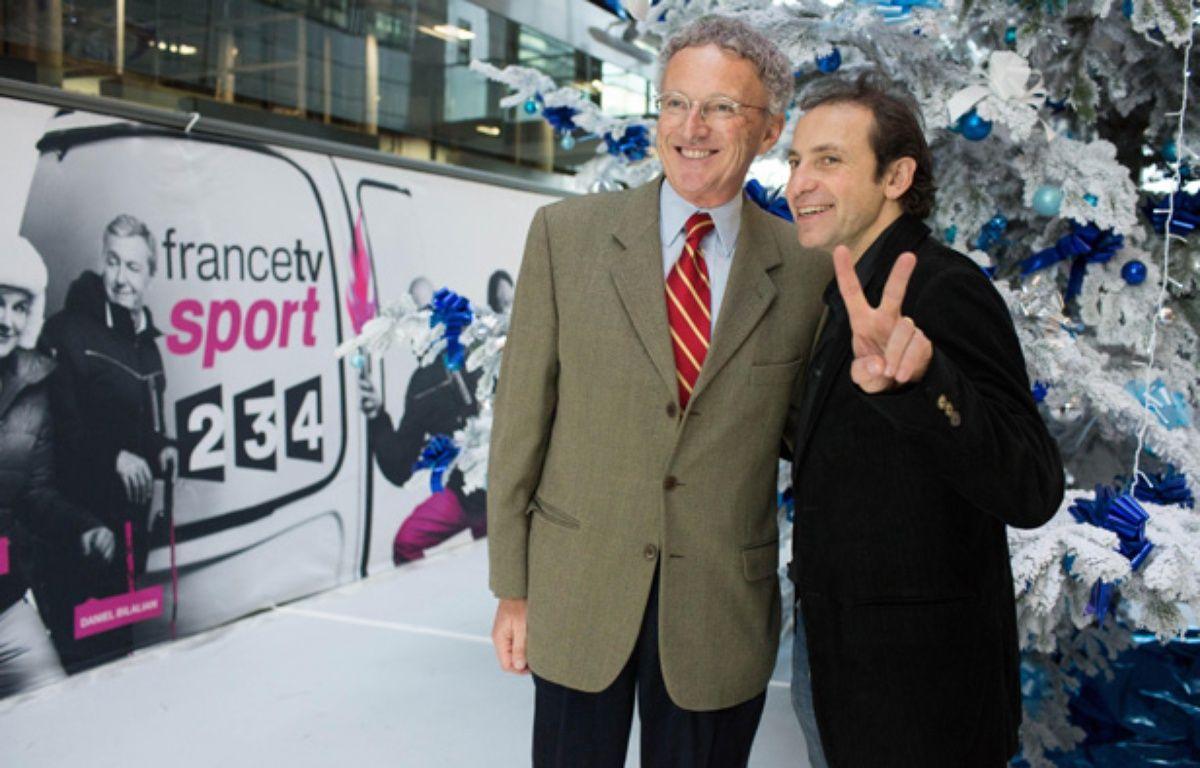Nelson Monfort (à g.) et Philippe Candeloro, les commentateurs de France Télévisions pour le patinage aux JO de Sotchi, le 17 décembre 2013 à Paris – REVELLI-BEAUMONT/SIPA/