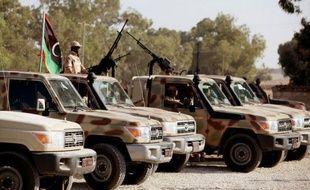 La confusion régnait en Libye samedi après des déclarations officielles contradictoires sur des arrestations de membres de l'ancien régime, au moment où des combats font des dizaines de morts et de blessé dans l'ouest du pays, un an jour pour jour après la mort de Mouammar Kadhafi.