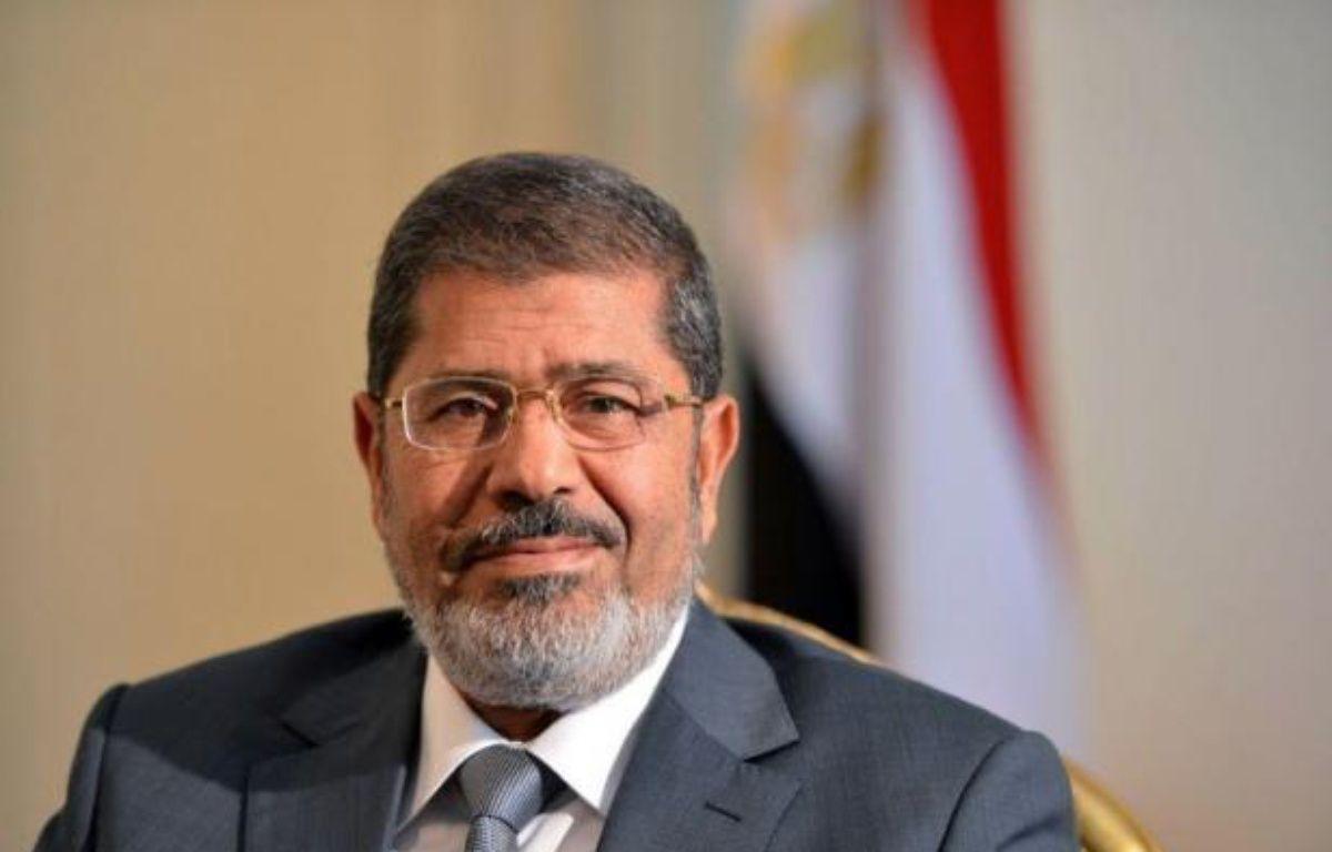 Le président égyptien Mohamed Morsi a décidé dimanche, une semaine environ après son investiture, d'annuler la dissolution du Parlement, rendant le pouvoir législatif que s'était attribué l'armée à l'Assemblée du peuple largement dominée par les islamistes. – Khaled Desouki afp.com