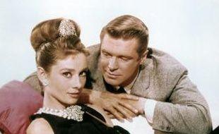 Audrey Hepburn et George Peppard, duo star de Diamants sur canapé, et l'inspecteur Clouseau Peter Sellers.