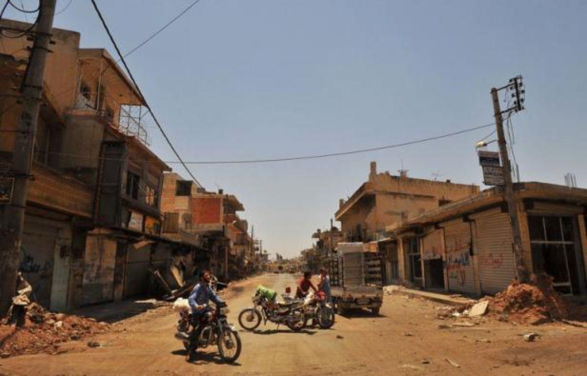 Plus de 300 personnes, en majorité des civils, ont péri jeudi dans la répression et les combats qui font rage à travers la Syrie, le bilan le plus lourd en 16 mois de révolte, selon un décompte de l'Observatoire syrien des droits de l'Homme (OSDH) publié vendredi. – Bulent Kilic afp.com