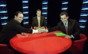 François Hollande et Nicolas Sarkozy sur le plateau de l'émission «Public», sur TF1, en 1999.