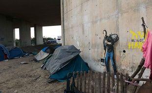 Une œuvre de Banksy, près de la Jungle à Calais.