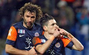 Les joueurs de Montpellier, Romain Pitau (à g.) et Rémi Cabella lors d'un match de Coupe de la Ligue, le 28 novembre 2012 contre Nice, à Montpellier.