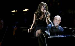 Le chanteur Billy Joel et sa fille Alexa Ray Joel lors d'un concert à New York en mai 2008