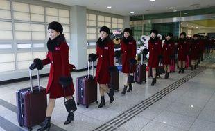 Sports et détentes - Page 6 310x190_pom-pom-girls-nord-coreennes-arrivees-jo