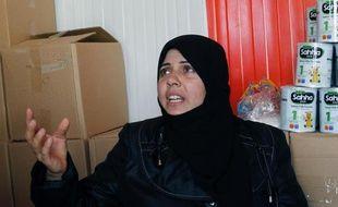 Epouse et mère de deux combattants rebelles, Fadia ne voulait pas quitter la Syrie en dépit des violences. Elle a fini par s'y résoudre devant l'insistance de son fils qui craignait pour sa famille en cas de frappe américaine.