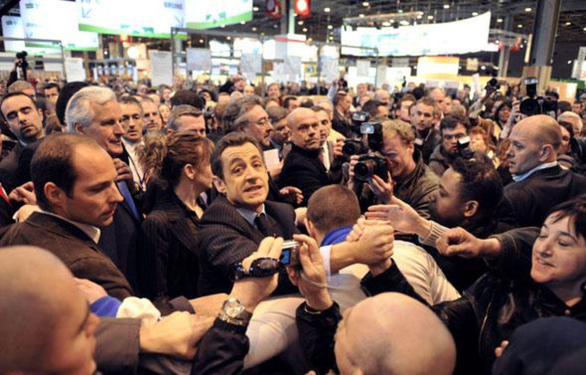C'est sans doute la phrase que tout un chacun retiendra du mandat de Nicolas Sarkozy: le «Casse-toi pauv'con» lancé à un badaud au Salon de l'agriculture le 23 février 2008.  – AFP
