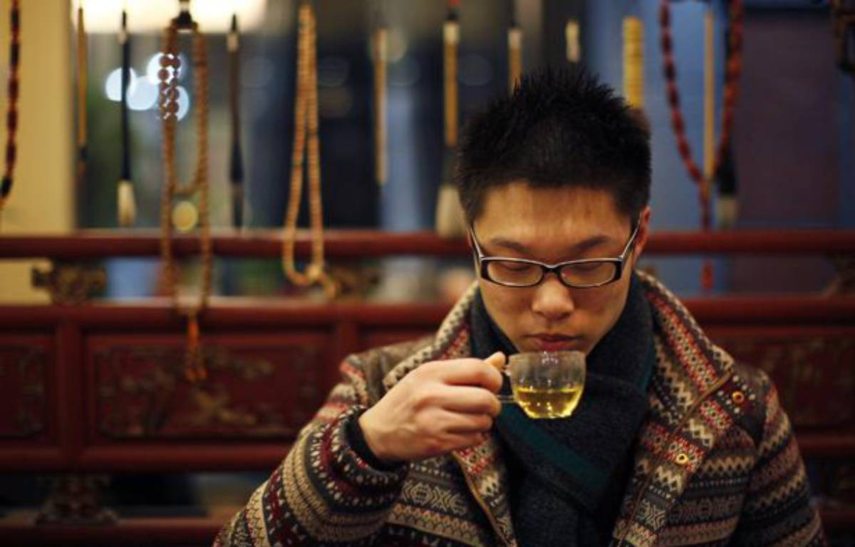 Shen Jun Yi drinks Tregothnan British tea at a tea house in the Hongqiao Antique and Tea Center in downtown Shanghai January 25, 2013. Tregothnan is bucking an historic trend by growing tea in England and exporting almost half of it abroad, including to tea-growing nations like China and India. Owned by a descendant of 19th century British Prime Minister Charles Grey, after whom the Earl Grey tea blend was named, the Tregothnan estate has been selling tea since 2005 and currently produces around 10 tonnes a year of tea and infusions. Picture taken January 25, 2013.  – REUTERS/Carlos Barria
