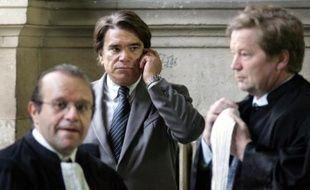 L'ex-ministre, 70 ans, qui a connu la gloire puis la prison avant de revenir aux affaires grâce à cette décision polémique qui lui avait octroyé plus de 400 millions d'euros en 2008, a dans la foulée été libéré sous contrôle judiciaire, avec interdiction de communiquer avec certains des protagonistes du dossier.