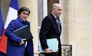 La ministre des sports Valérie Fourneyron et le ministre des affaires étrangères, Laurent Fabius, lors d'une réunion sur la diplomatie du sport français le 15 janvier 2014 à Paris