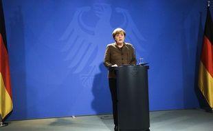 Angela Merkel lors de sa conférence de presse le 23 décembre à Berlin peu de temps après l'annonce de la mort d'Anis Amri.