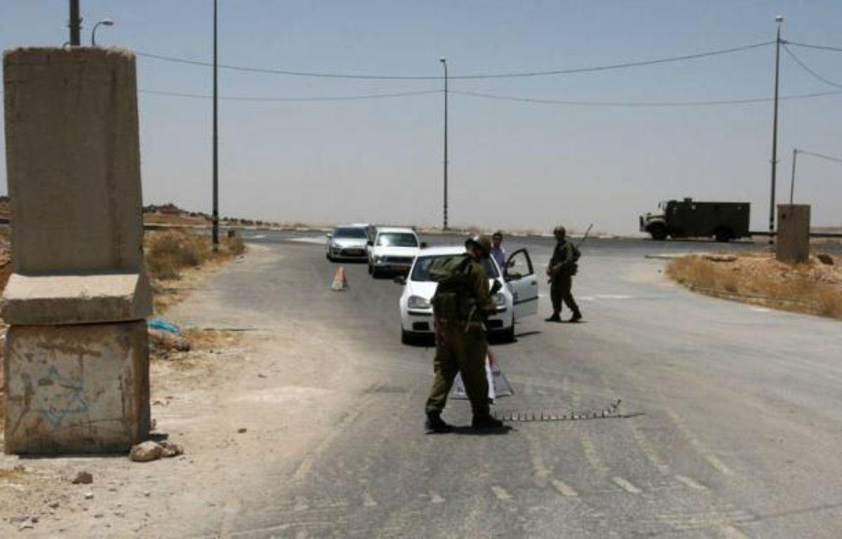 Deux Palestiniens ont été tués dimanche par balles par un chauffeur de camion israélien après avoir tenté de voler son véhicule près de Hébron, dans le sud de la Cisjordanie, a annoncé la police israélienne. – Hazem Bader afp.com