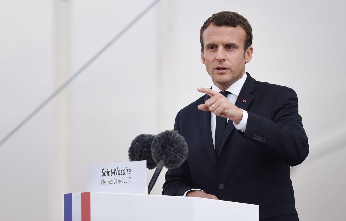 Emmanuel Macron s'impose comme un as de la com' : dernier «coup» en date, son allocution en direct et en anglais reprise par toutes les chaînes de TV américaines. – AFP
