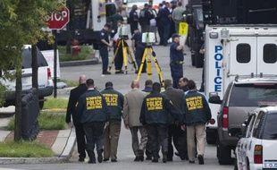 """L'auteur de la fusillade de Washington, qui a abattu douze personnes avant d'être tué lundi, """"errait"""" sans direction dans le bâtiment de la Marine à la recherche de """"gens à abattre"""", a révélé jeudi le directeur du FBI, James Comey."""