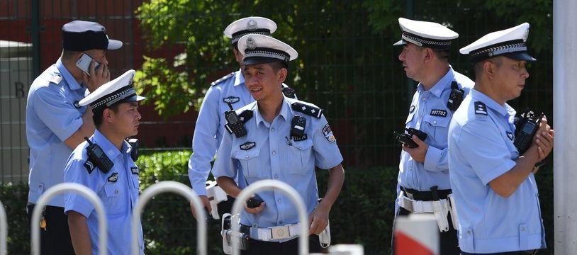 Des policiers chinois à Pekin, le 26 juillet 2018. (Illustration)