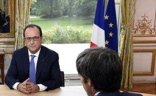 Le président français François Hollande au palais de l'Elysee à Paris le 14 juillet 2015