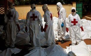 Des salariés de la Croix-Rouge internationale parmi les victimes des derniers massacres inter-communautaires à Bangui en Centrafrique, le 8 décembre 2013.