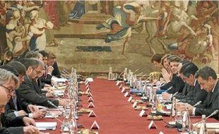 Hier, lors du sommet sur la crise qui se tenait à l'Elysée.