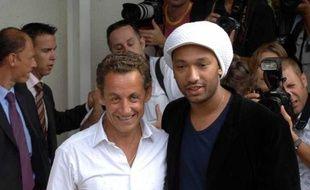 Nicolas Sarkozy et Doc Gynéco, en septembre 2006 à l'université d'été de l'UMP à Marseille.