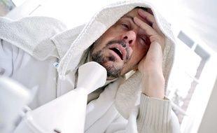 Illustration d'une personne malade souffrant de maux de tête.